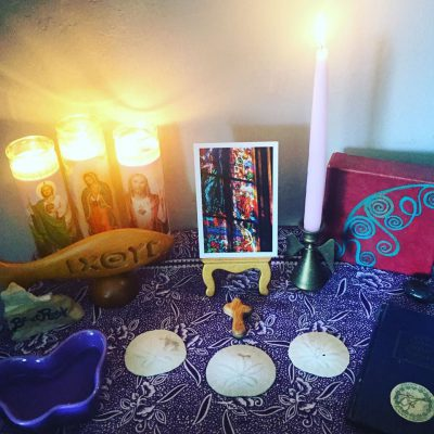 Home altar with sea shells and postcard