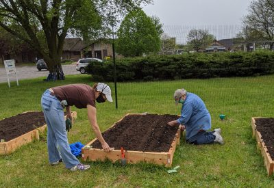 Volunteers plant veggie seeds in the new Good News Garden at Holy Trinity Episcopal Church in Wyoming, Michigan